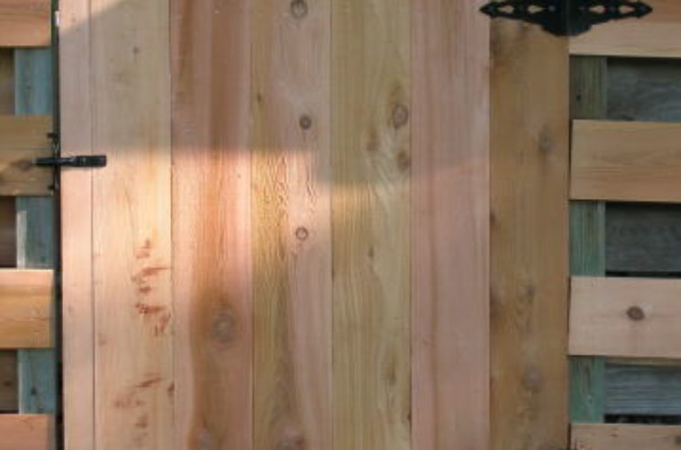 AFC Cedar Rapids - Wood Fencing, 1072 Custom Solid with Accent Top Gate