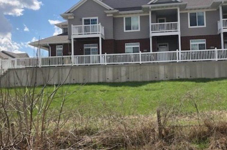 2 rail vinyl picket fence around apartment complex