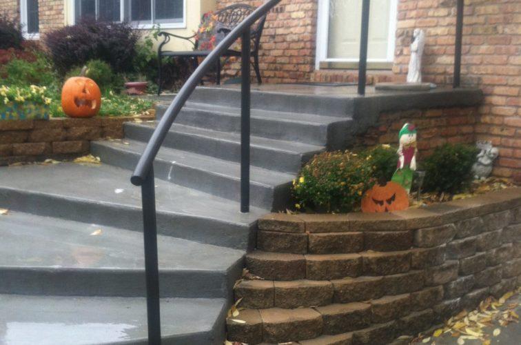 Custom iron railing down patio stairs