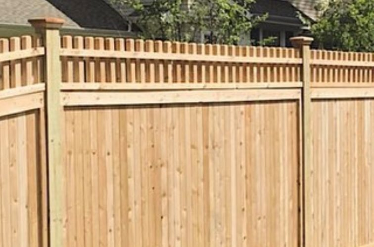 Wood solid privacy fence with custom picket accent