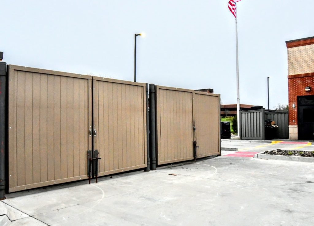 Composite dumpster enclosure swing gates