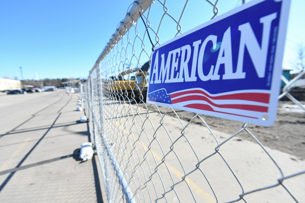 AFC Cedar Rapids - Rental fence panel with American Fence Company name plate