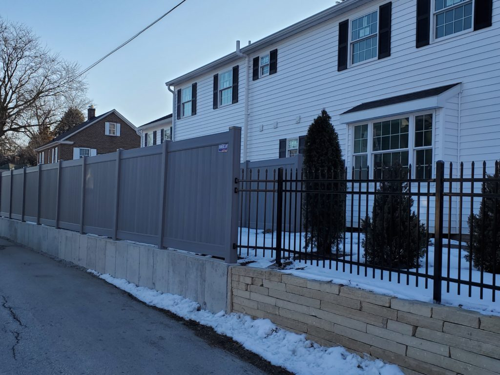 Residential vinyl fence installed in Cedar Rapids by American Fence Company