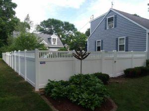 Vinyl privacy fence around a backyard in Cedar Rapids, IA