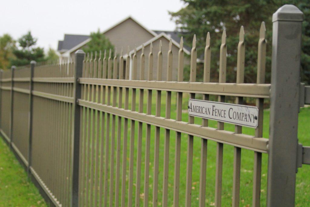 Tan ornamental picket fencing in Cedar Rapids, IA
